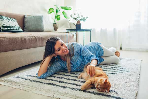 young woman lying carpeted rug
